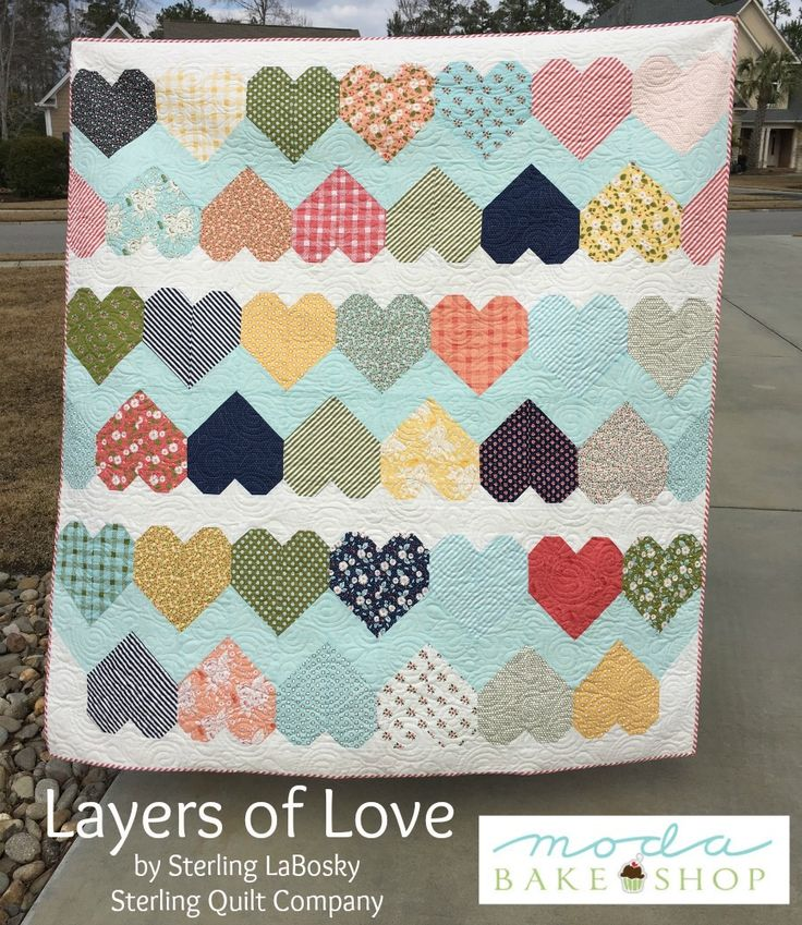 """Layers of Love Quilt-by Sterling LaBosky...This quilt finishes at 63″ x 69″. his layer cake friendly quilt makes it easy to wrap your sweetheart in """"Layers of Love."""""""