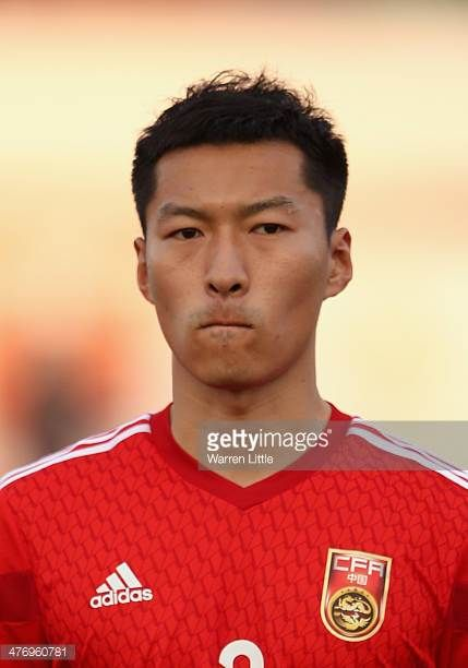 A portrait of Wu Xi of China during the Asian Cup Qualification match between China and Iraq at the AlSharjah Stadium on March 5 2014 in Sharjah...