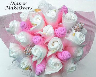 Surprise your new mom with a beautiful diaper bouquet. Looks fabulous when used for decorating at baby shower. Excellent way to show off your creative style.  You can select your own color combination. If you select CUSTOM COLOR OPTION please specify when completing order or send me a message, If no color is indicated it will be created in the colors of the primary photo.  Includes: glass vase, 24 size one diapers, 8 washcloths, tulle ribbon  All diaper bouquets are handmade. Each Diaper…