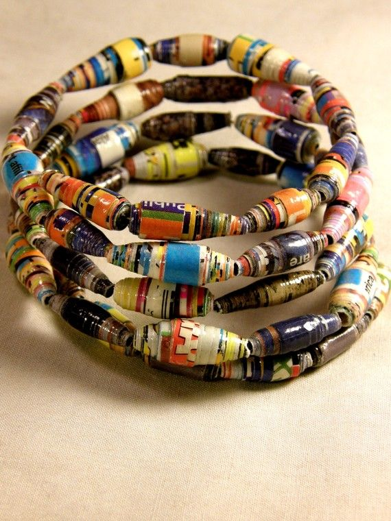 Paper bead bracelet using glossy magazines and varnish. I want to have a go at…
