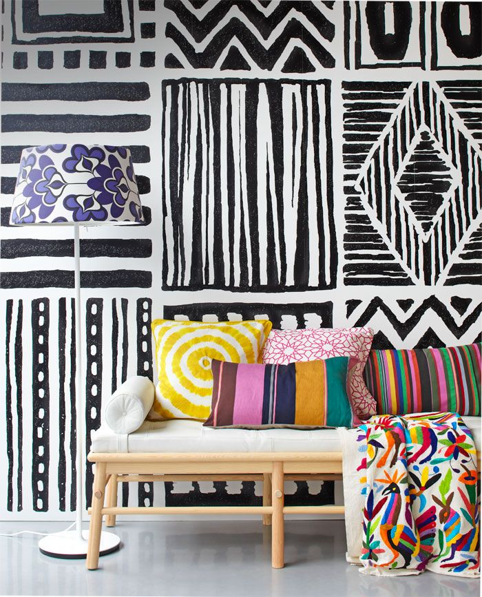 I love the black and white patterned wall with the bright coloured pillows. The bright colours are very bold and make the room come alive against the black and white wallpaper. This inspires me to mix different patterns and vibrant colours together to create a statement piece.
