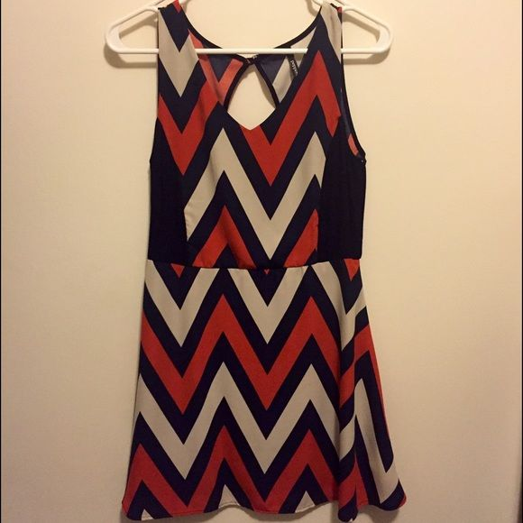 Navy Blue/Cream/Red Orange Chevron Dress Super cute v-neckline dress, perfect for any occasion! Can be dressed up with heels or worn with sandals for a more casual look. I've only worn it a few times because I have so many dresses so it's practically new! (Tags say it's a medium, but it fits like a small) Dresses Mini
