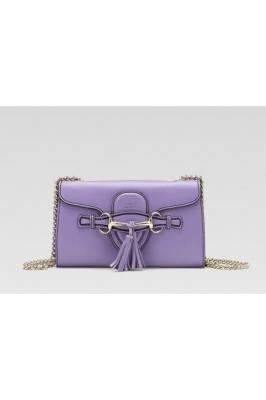 gucci handbag, gucci messenger bag, gucci clutch…love the style the color is eh ok