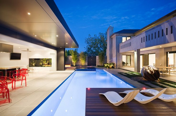 Viewing down the length of the pool, we see the intricate lighting scheme that places dozens of small recessed light sources throughout the interior, exterior, and within the pool itself.