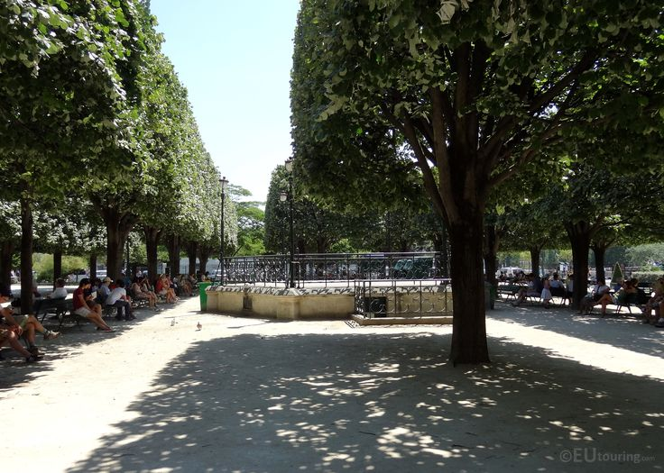 Taken from beneath an open area beneath some trees you can see a bandstand which is within the Square Jean XXIII, making it an ideal place for people to relax next to the Notre Dame and enjoy the shows preformed.  Daily updates at www.eutouring.com/square_jean_xxiii.html