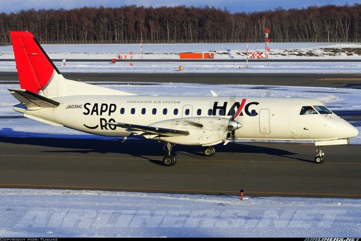Hokkaido Air System-HAC (JP) Saab 340 JA03HC aircraft, with the sticker ''SAPPORO'' on the airframe, skating at Japan Sapporo New Chitose International Airport. 04/01/2014.