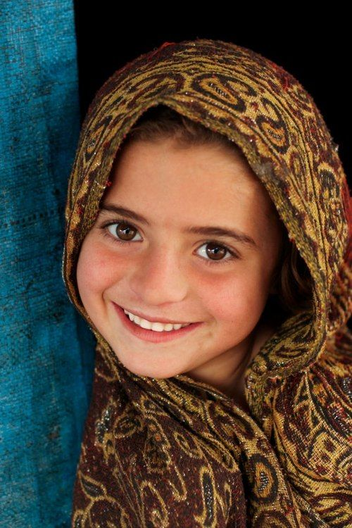 Arifa, outside her tent in Jalozai camp, Khyber-Pakhtunkhwa province in Pakistan