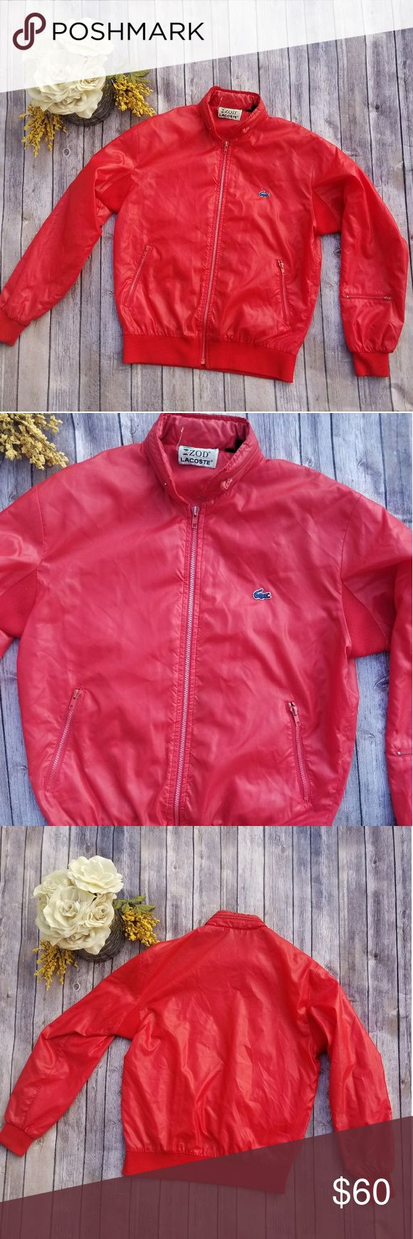 🎉Vintage Izod Lacoste Red Bomber Jacket🎉 Size M Vintage Izod Lacoste Bomber Jacket Red Alligator blue Zippers show signs of wear No tears  Photo 8 shows small stain (can be removed) Amazing vintage piece Lacoste Jackets & Coats