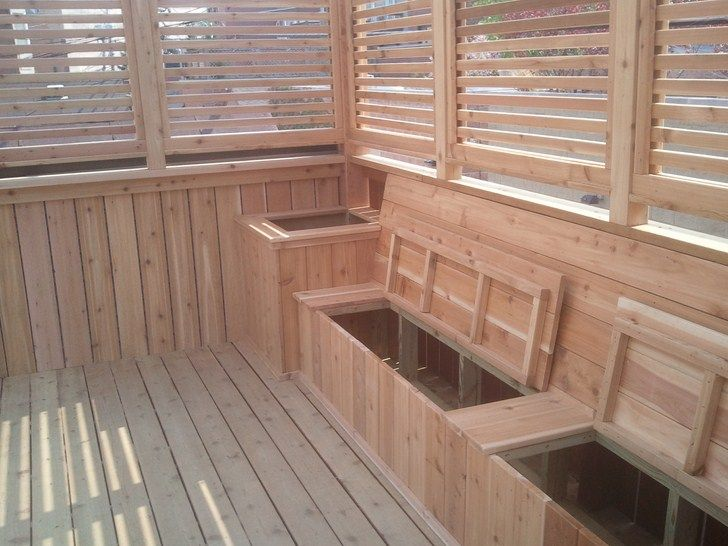LOVE this idea!  It would be super easy to do while adding bench seating to your deck!  Extra storage space? ......why, YES!