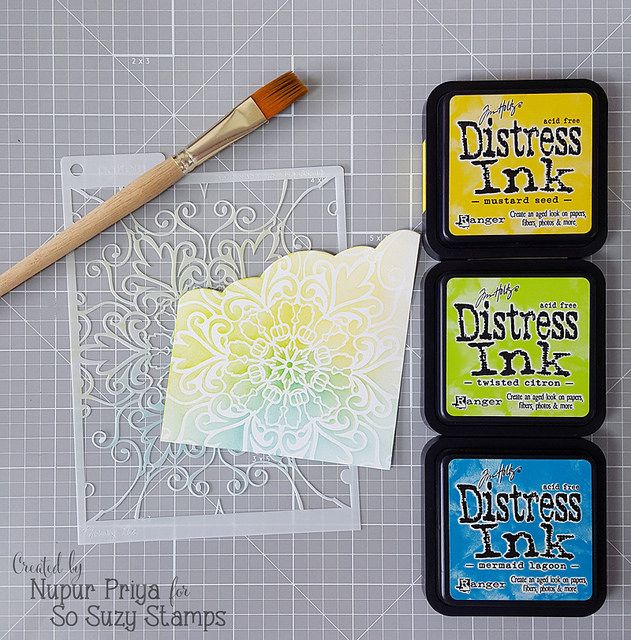 stencil technique explained in one photo by Nupur Creatives ... Distress Inks ... soft color ...