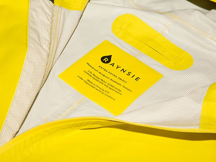 RAYNSIE DIP YELLOW RED - detail of 2.5L lightweight waterproof/breathable nylon fabric  RAYNSIE is a weatherproof coverall, optimized for city riders. Premium performance raingear, designed to welcome any meteorological challenge with open arms. It's waterproof, windproof, breathable and packable.