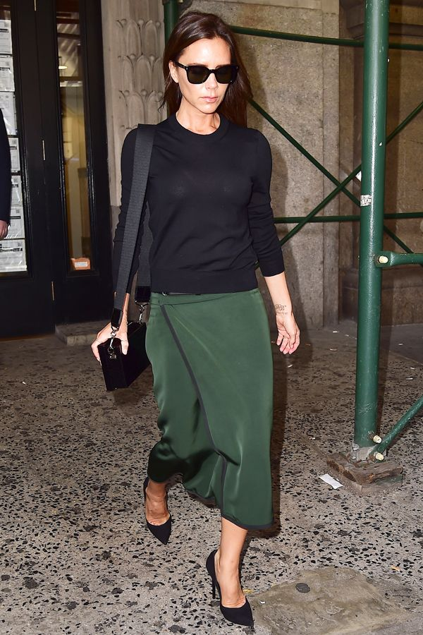 Victoria Beckham's Best Street Style, Decoded #refinery29  http://www.refinery29.com/2015/01/81174/victoria-beckham-best-outfits#slide-4  New York Fashion Week is all business for Beckham: While in town to present her spring '15 collection, Victoria kept her look simple and clean-cut in a black sweater, wrap-around green skirt, and a pair of Manolo Blahnik pumps.