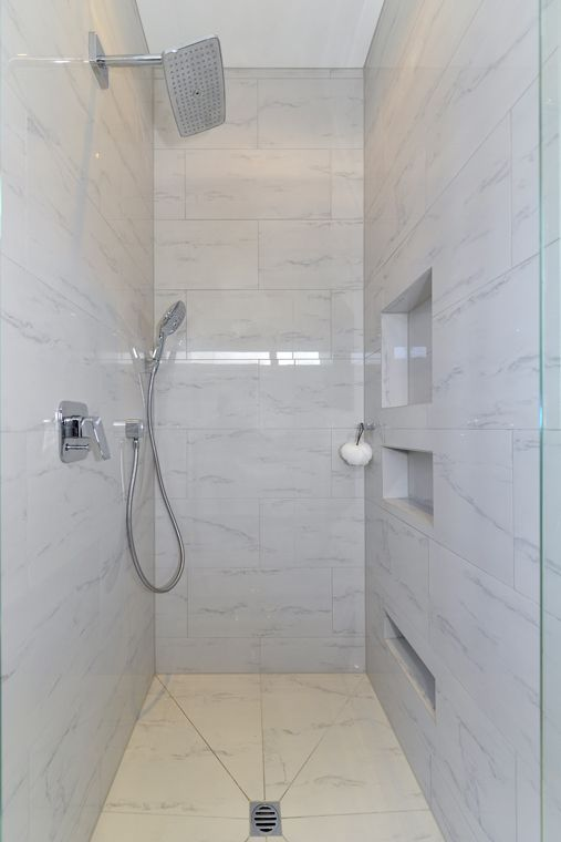 This shower is big and has room for bottles and you can also choose which shower head to use