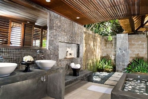 I like the way of getting light to the lower area through the slatted flooring.     justthedesign:    justthedesign:Balinese Bathroom