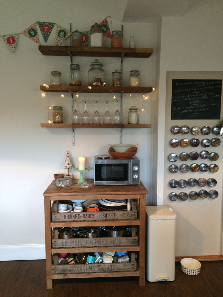 Finally got my shelves up after 5 years or nagging! Beech wood worktops cut down to size from Wickes with some brackets my FIL kindly gave us. The sideboard underneath is from Hunter Rose in Shoreham. My magnetic spice jars are from Ikea and they're held up by metal table