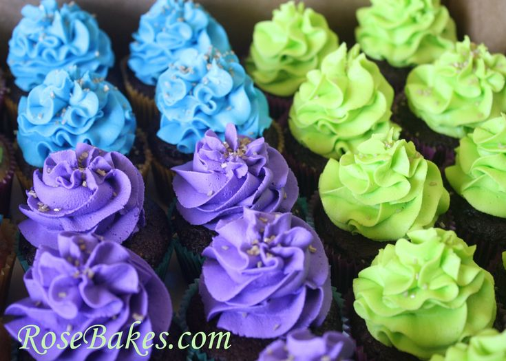 Peacock themed cupcakes in vibrant shades of blue, purple and green.