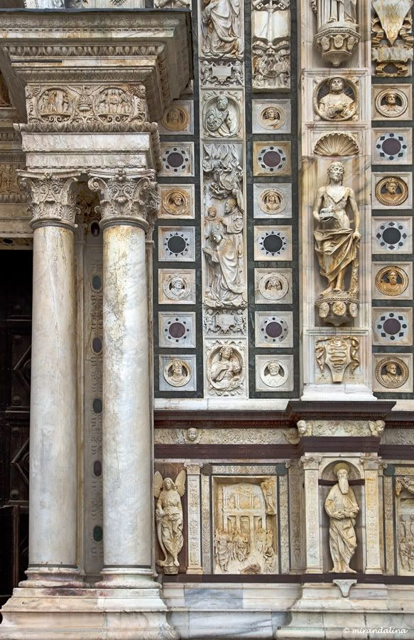 Certosa di Pavia - detail of the rich sculptural decoration of the facade completed 1507, Pavia, Lombardy, Italy