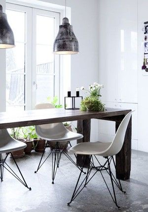Im drawn to the juxtaposition of modern eames style chairs against a rustic wood table