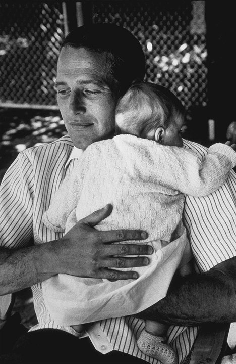 """Hollywood's hottest dad ever? Paul Newman (holding daughter Claire """"Clea"""" Olivia in 1965) gets our vote! (Photo by David Sutton/mptvimages.com) #FathersDay"""