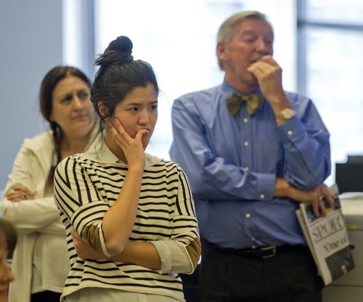 Reporter Jennifer Yang in front of columnist Rosie DiManno and TorStar Chair of the Board, John Honderich. (Rick Madonik/Toronto Star)