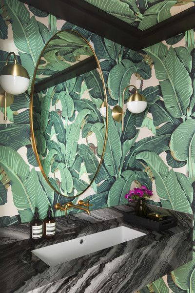 Palm leaf wallpaper in bathroom.