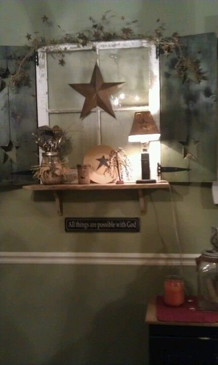 old window ~ charming vignette. lovely glow from the lamp. great little barn star!