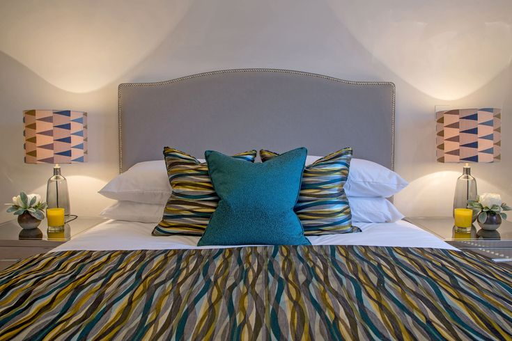 This bedroom design is strewn with vibrant colours and patterns, the deep teals and yellows adding vitality and vivacious personality to the interiors.