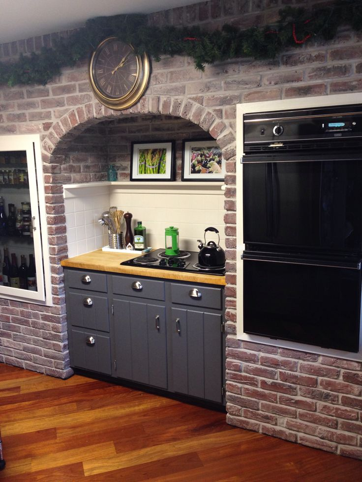 "Brick archway in kitchen regrouted and whitewashed. Cabinets: Sherwin Williams ""Peppercorn."""