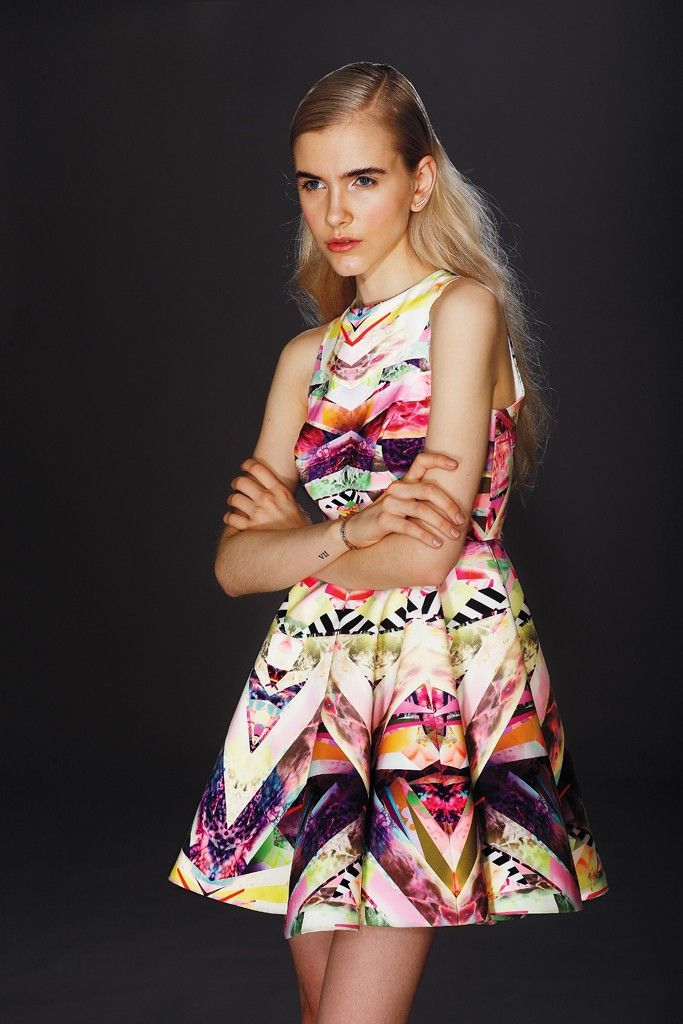AQ/AQ's polyester full-skirt dress in kaleidoscopic print. Graziela Gems earrings and Iwona Ludyga Design necklace.
