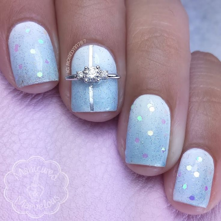 www.JamesAllen.com White Three Stone Nail Jewel is set against this baby blue mani by Preen Me VIP  nail artist Roselynn M. making it absolutely swoon worthy and an ideal nail look for a bride. #PutARingOnIt
