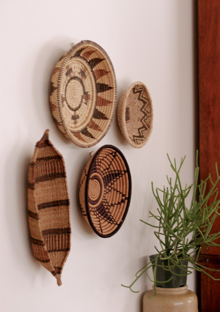 A Woven Dress Featuring An Allover: Wall Decor, Woven Baskets And
