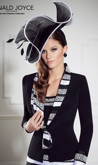 A classic black and white wedding guest outfit from Veni Infantino by Ronald Joyce.