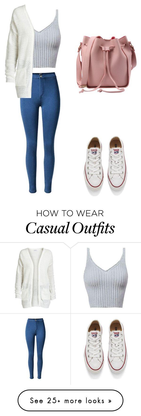 converse, pantalón alto azul, blusa gris, sueter blanco.