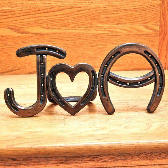 wedding monogram made out of horseshoes :)
