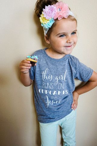 "I totally need a shirt like this- don't even care if it's for kids haha! ""This girl runs on cupcakes and Jesus"""