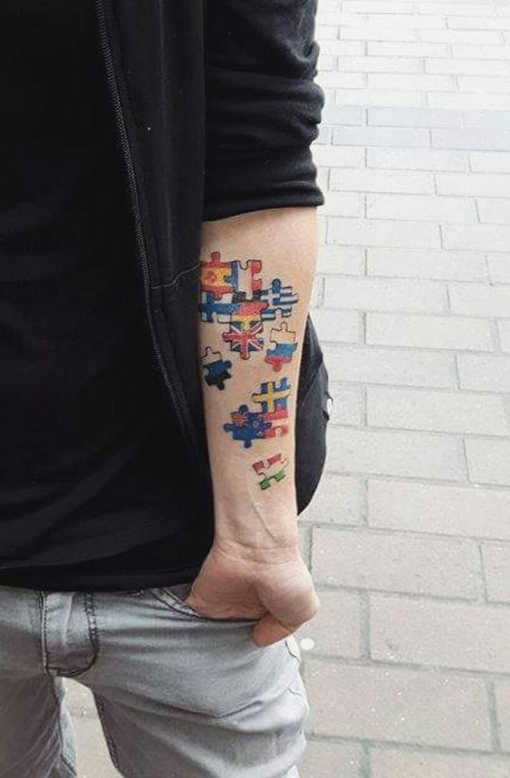 Travel puzzle piece flags tattoo