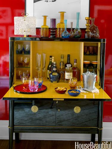 Look at that lacquer! This is a bar cabinet, but the technique would work great on a fold-up desk as well.