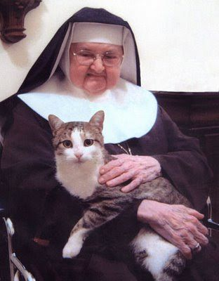 Mother Angelica holding the cat that belongs to all the Nuns.