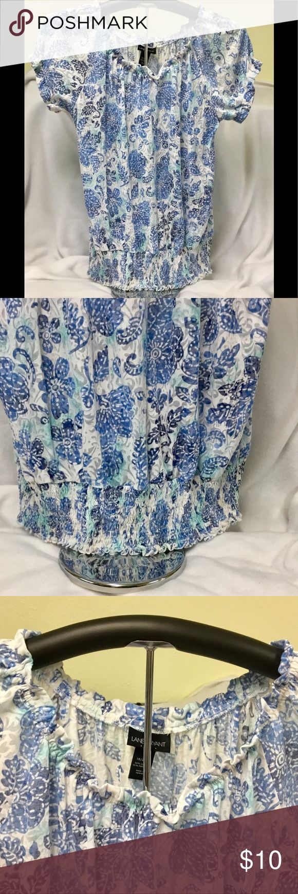Lane Bryant Plus Size 18/20W Short Sleeve Top Lane Bryant Plus Size Short Sleeve Top with Elastic Bottom, Sleeves, & Neckline. Cotton Polyester cutout floral material in blue, green, & white background.  Shirt in Very Good Used Condition. Lane Bryant Tops Blouses