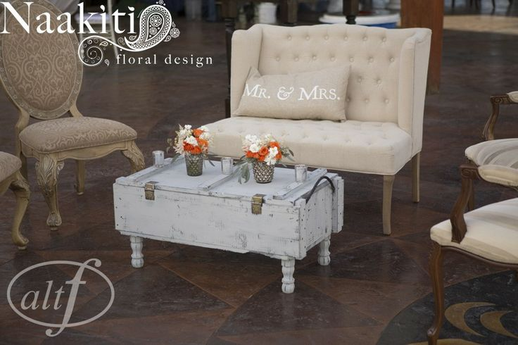 An arrangement of different style furniture was used for cocktail hour. #cocktail #hour #furniture #romantic #naakitifloral #altf #mr #mrs #pillows #wedding