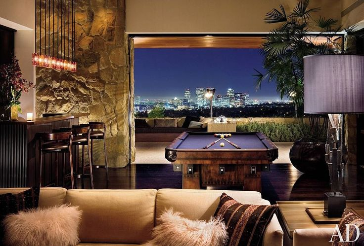 Quite the party house, this game room features a vintage pool table, mood lighting, and a killer view.  Photo by Scott Frances via Architect...