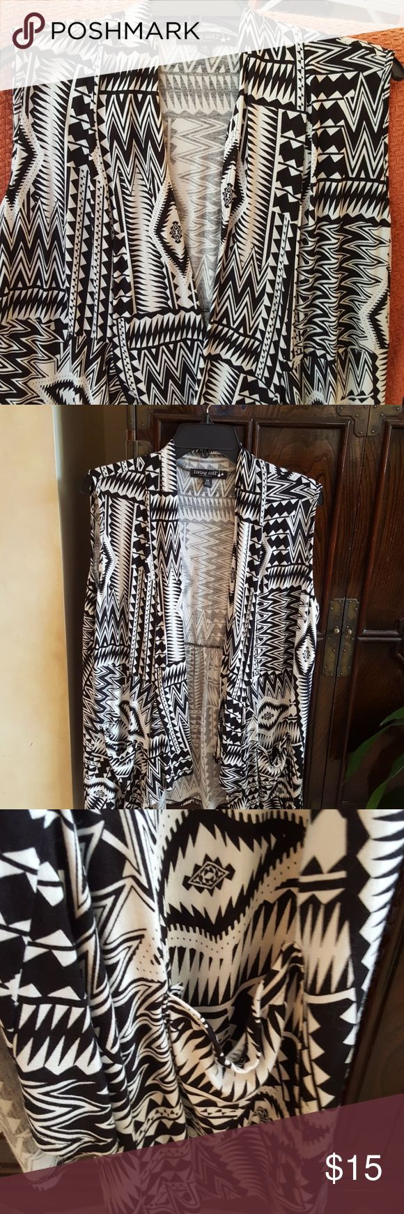 Adorable black and white vest/jacket This vest is in EUC.  It was maybe worn twice.  Make me an offer. Jackets & Coats Vests