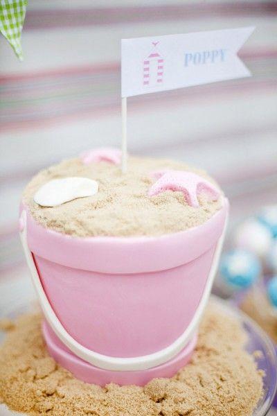Gorgeous beach-themed bucket of sand cake. Yummy!