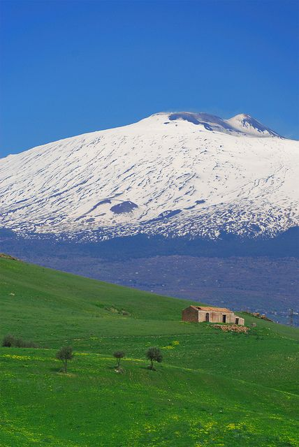 Mt. Etna, Sicily, Italy. Mount Etna is an active stratovolcano on the east coast of Sicily, Italy, close to Messina and Catania. It lies above the convergent plate margin between the African Plate and the Eurasian Plate.