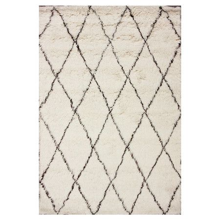 Wool shag rug with a diamond trellis motif. Handmade in India.  Product: RugConstruction Material: Wool...