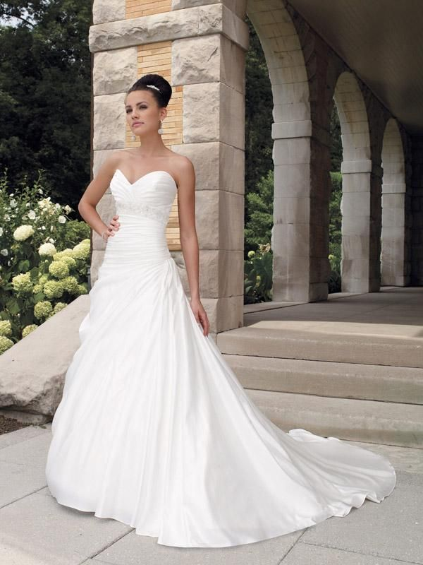 Elegant Strapless Beaded A-line/Princess Satin Wedding Dress Strapless sweetheart satin faced taffeta A-line gown, softly pleated bodice emphasized by hand-beaded crystal Empire band, asymmetrical waistline extends into draped skirt, chapel length train, detachable spaghetti and halter straps available.