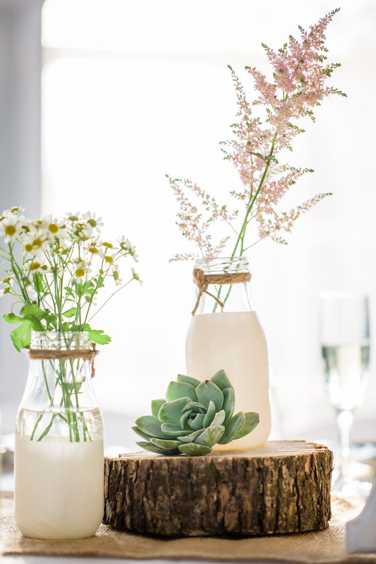 DIY Milk Bottle Centerpieces with Wildflowers - would be just as pretty without the milk glass look