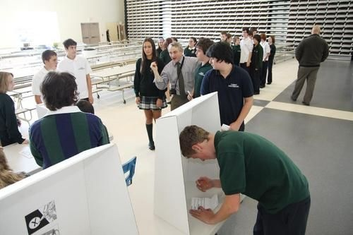 Liam Marcolini, 13, right, of St. Benedict Catholic Secondary School, selects a candidate for the provincial election during a mock vote at the Sudbury school on Tuesday, Oct. 4, 2011.