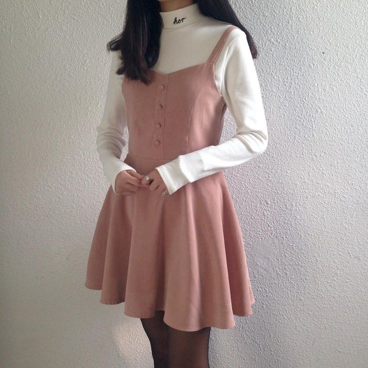 pink buttoned babydoll dress with a white sweater long sleeved turtleneck layered underneath from mixxmix