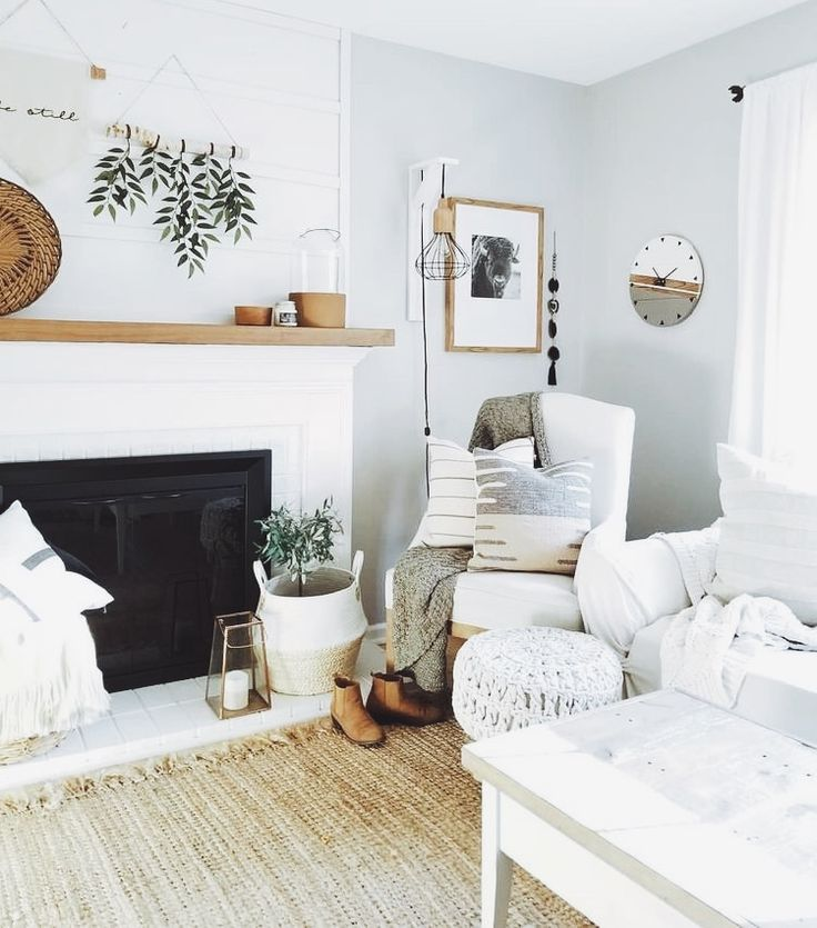 Gorgeous white and neutral living room decor. LOVE the pops of greenery and the soft materials.